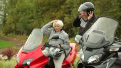 Senior couple on scooters, ready to ride Stock Footage