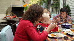 Group of people eating at outdoor dinner party - stock footage