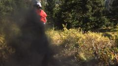 Dirt and dust flies behind mountain biker, slow motion - stock footage