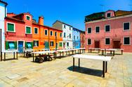 Stock Photo of venice landmark, burano old market square, colorful houses, italy