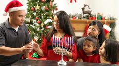 Hispanic family together lighting Menorah at Christmas - stock footage
