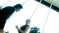 Confident attractive businesswoman strides through a large contemporary office Stock Footage