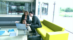 Track and Dolly. Multi ethnic young professionals in a meeting area of large Stock Footage