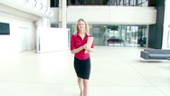 Stock Video Footage of Steadicam through large contemporary office atrium, following a large multi