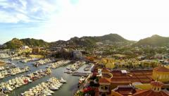 Stock Video Footage of Cabo aerial flyover of Marina at Sunset