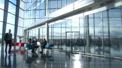Business executives in relaxed meeting area of large corporate business - stock footage