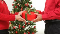 Mature couple exchanging gifts on Christmas day - stock footage