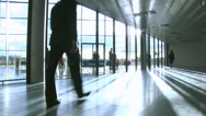 Stock Video Footage of Business group in a large contemporary office building. High quality HD video