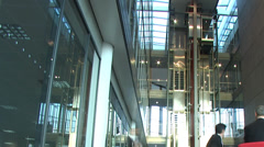Time lapse of busy business people in a large contemporary office building. High - stock footage