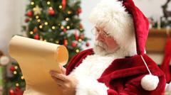 Santa Claus writing on scroll - stock footage