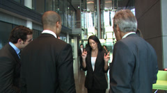 Business group discussion in a large contemporary office building. High quality - stock footage