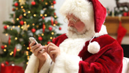 Stock Video Footage of Santa Claus talking on cell phone at Christmas