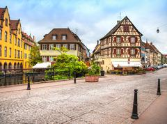 colmar, petit venice, canal bridge and traditional half timbered houses. alsa - stock photo