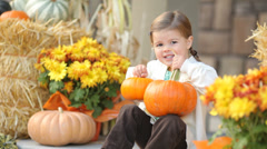Portrait of young girl with pumpkins in the Fall Stock Footage