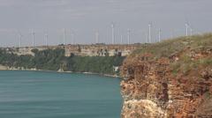 Wind turbine renewable ocean sea coastline group windmill energy production farm Stock Footage