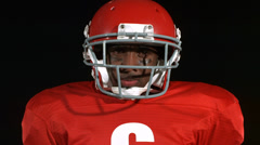 Closeup portrait of football player Stock Footage