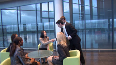 Manager welcomes business staff and escorts them through grand financial Stock Footage