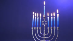 Traditional Jewish Menorah with candles lit - stock footage