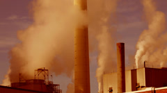 Smoke billows from factory - stock footage