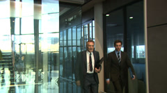 Business people walking through a large contemporary office building. High Stock Footage