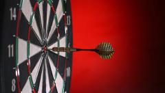Darts hitting dartboard, multiple shots, slow motion - stock footage