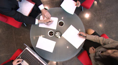 Business meeting over coffee in large financial building.  High quality HD video Stock Footage