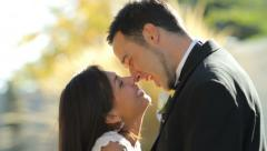 Bride and groom at wedding kiss Stock Footage
