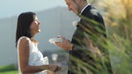 Stock Video Footage of Bride and groom at wedding feed each other cake