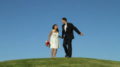 Stock Video Footage of Bride and groom outdoors jumping into sky