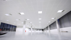 Business executives walking into new modern office space. Shot on Varicam Stock Footage