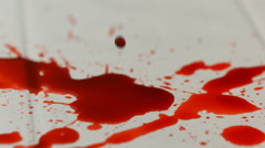 Dripping into pool of blood, slow motion Stock Footage