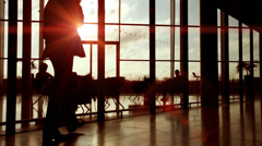 Business group walking through large contemporary office building at sunrise. Stock Footage