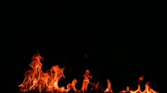 Flames on black background, slow motion - stock footage