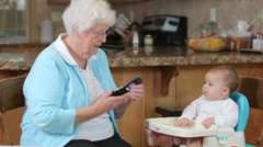 Grandmother with baby granddaughter Stock Footage
