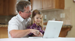 Grandfather and granddaughter on laptop Stock Footage