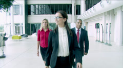 Attractive young multi ethnic business group come together as a team within a - stock footage