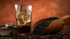 Pouring iced coffee, slow motion - stock footage