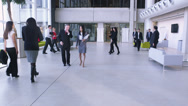 Stock Video Footage of Dolly back through office following large group of business people.  Team of