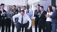 Stock Video Footage of Funny dancing businessman.  Excited group of business people clap their strange