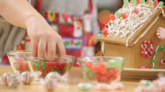 Closeup of young boy making gingerbread house Stock Footage