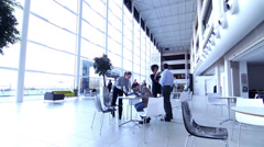 Large office team time lapse.  People shaking hands in office foyer reception. Stock Footage