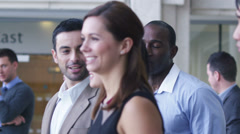 Large group of businessmen and businesswomen in the city Stock Footage