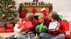 Family opening Christmas gifts - stock footage