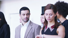 Large group of businessmen and businesswomen in the city. Large open corporate Stock Footage
