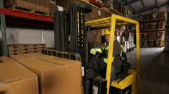 Forklift operator in a shipping warehouse Stock Footage