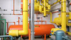 Colorful pipes in warehouse interior - stock footage