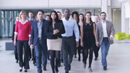 Stock Video Footage of Portrait of a large business team. Content young business team smiling into