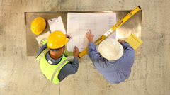 Construction Industry, contractors look over blueprints - stock footage