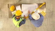 Stock Video Footage of Construction Industry, contractors look over blueprints