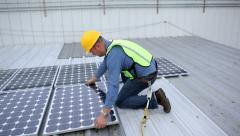 Contractor installing solar panels on rooftop Stock Footage